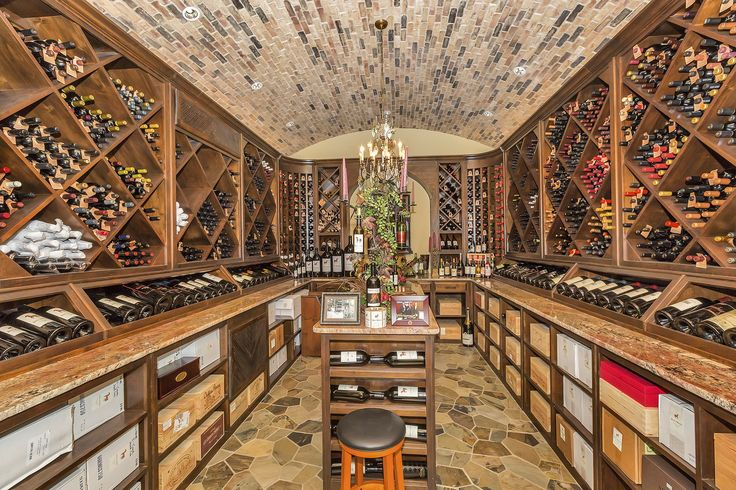 This Tuscan Style Texas Mansion Has An Incredible 6 000 Bottle Wine Cellar Wine Cellar Design Tuscan Style Wine Cellar