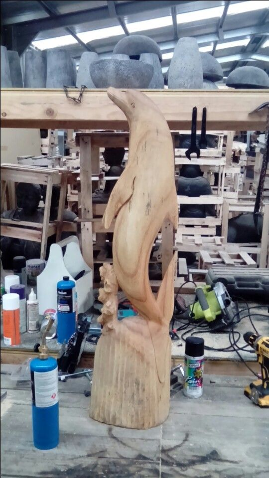 Rejuvenating old wood sculptures with a blow torch, before
