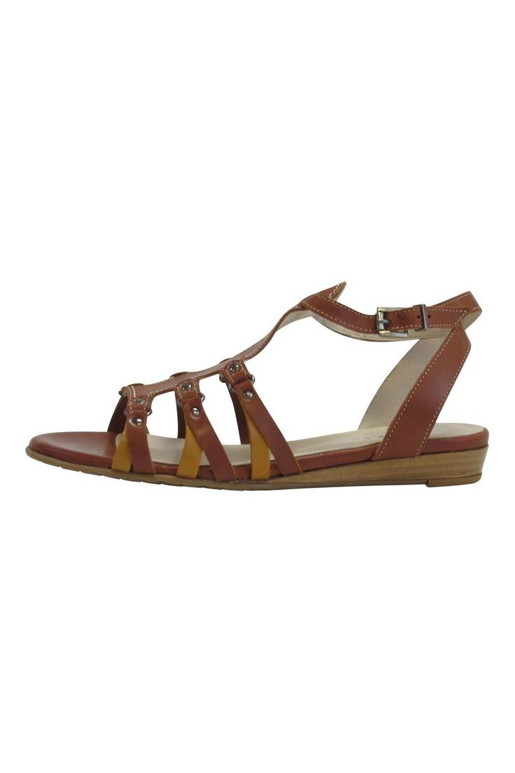 "This fun and funky sandal is hand crafted with high quality european leather, solid rubber sole for traction and buckle ankle strap. Finished off with beautiful contrast stitching and mustard colored leather details.    Approximate 1/2"" stacked wood heel. Size 37.5 fits US size 6.5.   Strappy Leather Sandals by Fidji. Shoes - Sandals - Flat California"