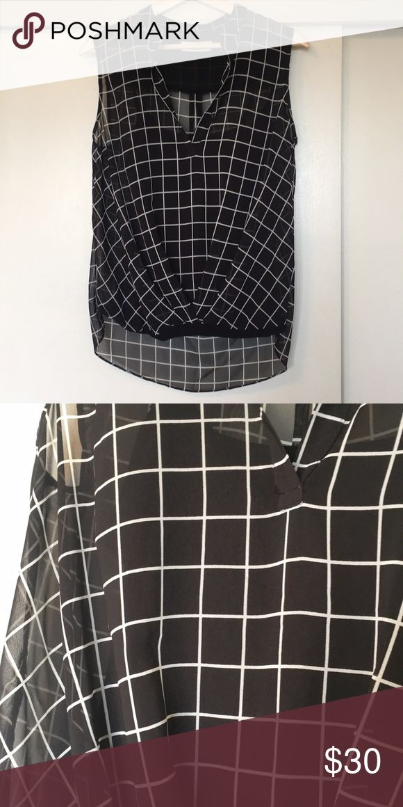 Saks Off Fifth- Sheer Overlay Blouse Black blouse with white grid pattern and high-low shape. Sheer overlay with built-in black cami. Purchased at Saks off Fifth and worn a couple of times. Bailey 44 Tops Blouses