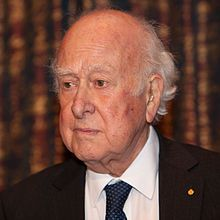 Peter Higgs (Newcastle, 1929) proposed a broken symmetry in electroweak theory, explaining the origin of mass of elementary particles in general and of the W and Z bosons in particular. This so-called Higgs mechanism predicts the existence of a new particle, the Higgs boson which was experimentally detected at CERN on 4 July 2012. The Higgs mechanism is generally accepted as an important ingredient in the Standard Model of particle physics, without which certain particles would have no mass.