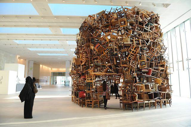 As part of Abu Dhabi's fourth annual art fair, Japanese artist Tadashai Kawamata created a round tower made of thousands stacked chairs.
