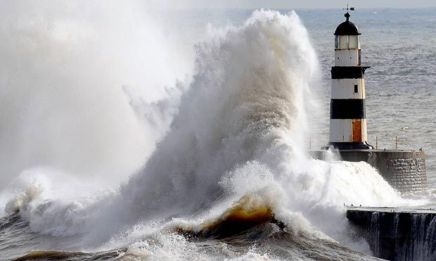 Seaham Lighthouse, in County Durham, is battered by huge waves driven by gale force winds off the North Sea