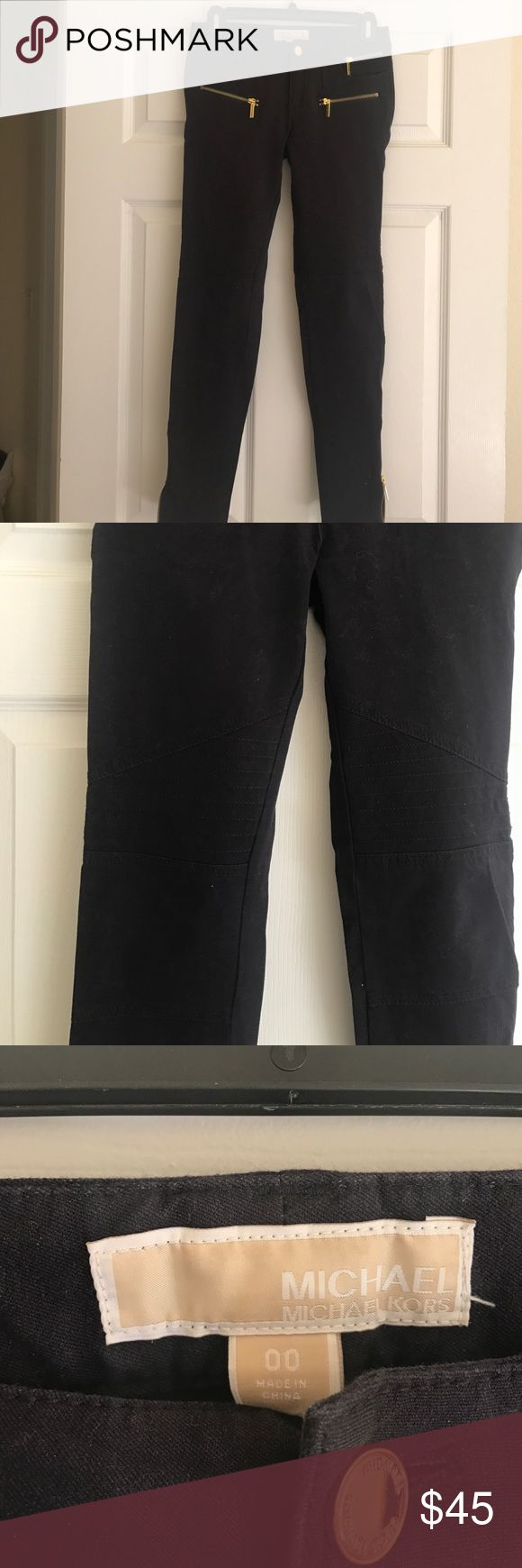 Navy Michael Kors moto pants Refectory condition. Never worn. Navy blue moto MK pants with gold zipper accents on pockets and bottom of legs. Only selling bc I just never wore them MICHAEL Michael Kors Pants