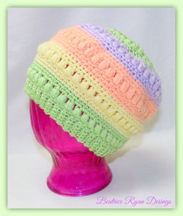 Whimsical Warmth Childrens Hat by Beatrice Ryan Designs. Make this sweet striped hat with Lion Brand Pound of Love! Pattern calls for Pastel Green, Honey Bee, Creamsicle, and Lavender and a size D crochet hook.