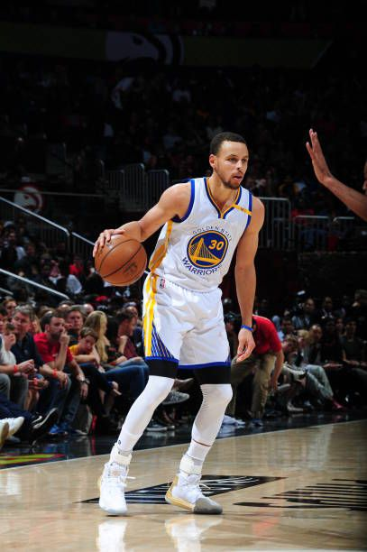 Stephen Curry of the Golden State Warriors handles the ball against the Atlanta Hawks on March 6 2017 at Philips Arena in Atlanta Georgia NOTE TO...