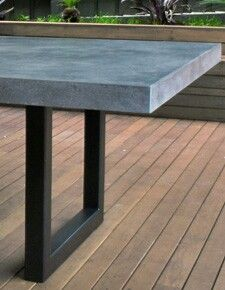 The combination of polished concrete and steel make a beautifully functional table for indoor or outdoor entertaining. High quality furniture designed and made in Melbourne.