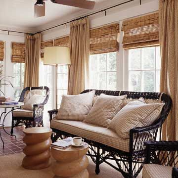 These bamboo blinds are an inexpensive way to add texture and control light in a porch. The blinds give privacy and block some light, but still allow small amounts of light into the room. This is an ideal treatment for a sun porch. Drapery panels add softness and color.