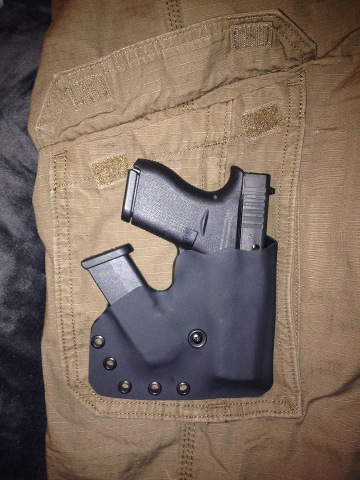 Glock 42 and spare mag in a cargo pocket holster.       Black .060 kydex