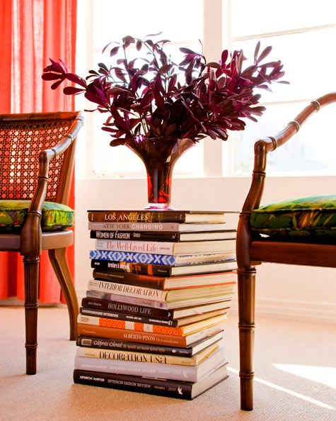 Stack books to make a low surface for display. | 24 Creative Ways To Decorate Your Place For Free