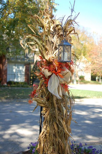 fall outside decoration corn stalk over the shepards hook with a lantern - Fall Outside Decorations