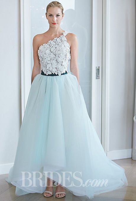 """Brides.com: 34 Colorful Wedding Dresses That Prove You Don't Have to Wear White. Style 311, """"Rose Mystic"""" ivory and blue tulle and lace one-shoulder A-line wedding dress with embroidered bodice and strap, Edgardo Bonilla  See wedding dresses from Edgardo Bonilla's most recent bridal runway show."""