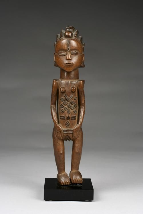 """Democratic Republic of the Congo; Luba figure - This magnificent figure is a model for Luba body arts, and demonstrates the degree to which perfection of the body was considered a significant communicative social process for Luba people in late precolonial and early colonial times. The coiffure, for instance, is of the """"cascade"""" style called mabutu - READ on"""