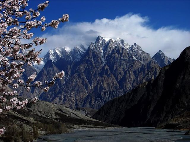 """Tupopdan, 6,106 metres (20,033 ft), also known as """"Passu Cones"""" or """"Passu Cathedral"""", the most photographed peak of the region , Hunza valley Pakistan ."""
