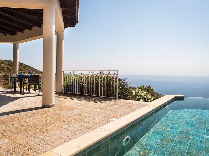 YOUR PRIVATE COUPLES' GETAWAY IN KEFALONIA. Villa Eros is a stunningly stylish villa with quiet elegance and intimate romantic charm. A perfect couple's retreat, nestled high on the hills above the resort of Skala, with dramatic landscape & sea views over the Ionian and other Greek Islands.
