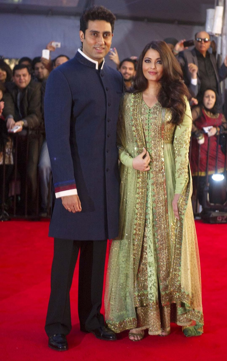 Abhishek Bachchan and wife Aishwarya Rai Bachchan arrive at the Times of India Film Awards gala ceremony at BC Place in Vancouver, B.C., Saturday, April 6, 2013. Les Bazso/PNG