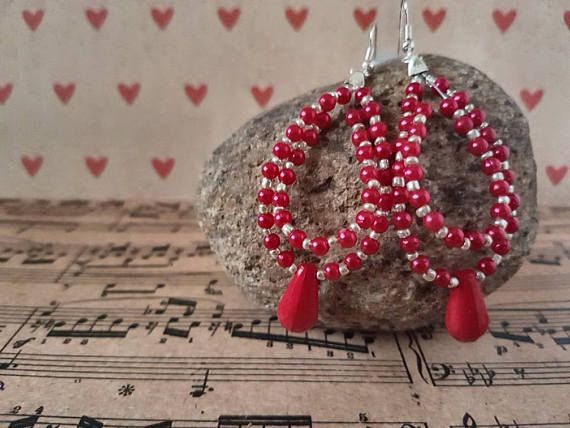 Check out this item in my Etsy shop https://www.etsy.com/au/listing/540205227/handmade-red-beaded-looped-earrings