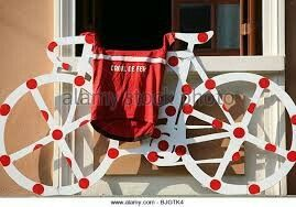 Bicycle sculpture painted in a red polkadots outside window of the St Georges Hotel, Tuscany