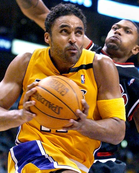 LA lakers | Rick Fox. He's such an idiot.  Vanessa Williams is a hottie