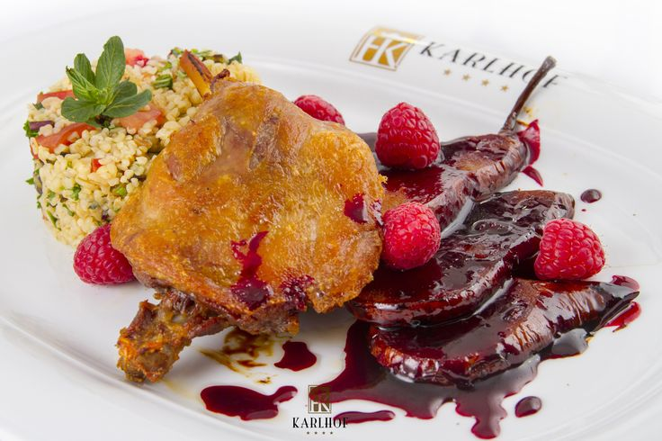 Duck leg with bulgur wheat and beetroot and raspberries cream