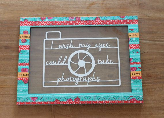 "Papercut art quote in an unique colorful frame; ""I wish my eyes could take photgraphs""."
