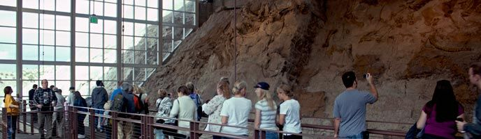 Dinosaur National Monument, UT...Visitors wander along the upper mezzanine at the Quarry Exhibit Hall.