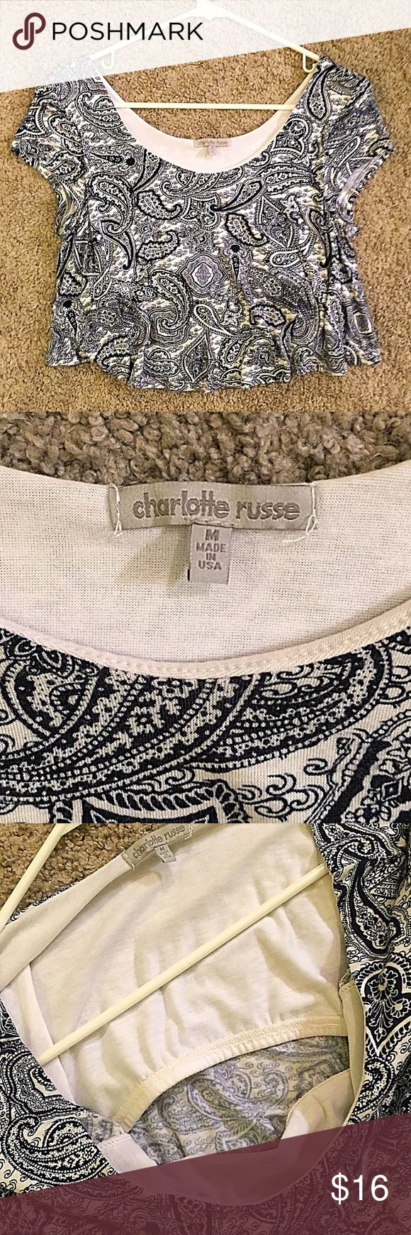 Charlotte Russe paisley crop top medium CHARLOTTE RUSSE blue and white crop top with paisley pattern. Has built in shelf bra and is very flowy and cute. Never worn and perfect condition ( NWOTs). Listed size medium but would also fit small Charlotte Russe Tops Crop Tops