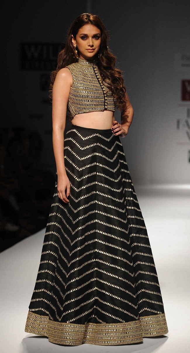 Aditi Rao Hydari in Payal Singhal Another favourite black lehenga we couldn't help but include. We love this piece by Payal Singhal at Lakme Fashion Week, especially the gold high neck blouse with button detailing at the front. A festive outfit for a wedding reception or pre-wedding cocktail. Indian designer - Indian couture #thecrimsonbride
