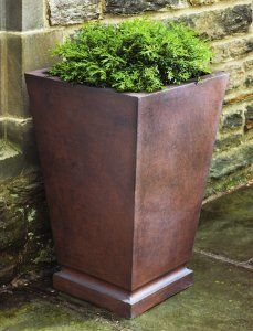 tall copper planters. buy cheap, spray with metal spray paint.