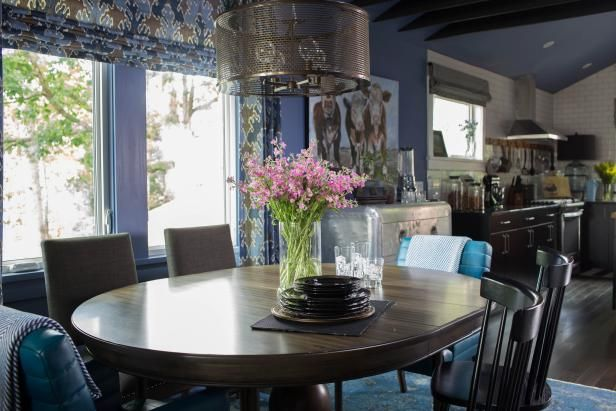 Projecting from the kitchen, a dedicated dining space offers a quite spot to reconvene after a day spent outdoors. From the experts at HGTV.com.