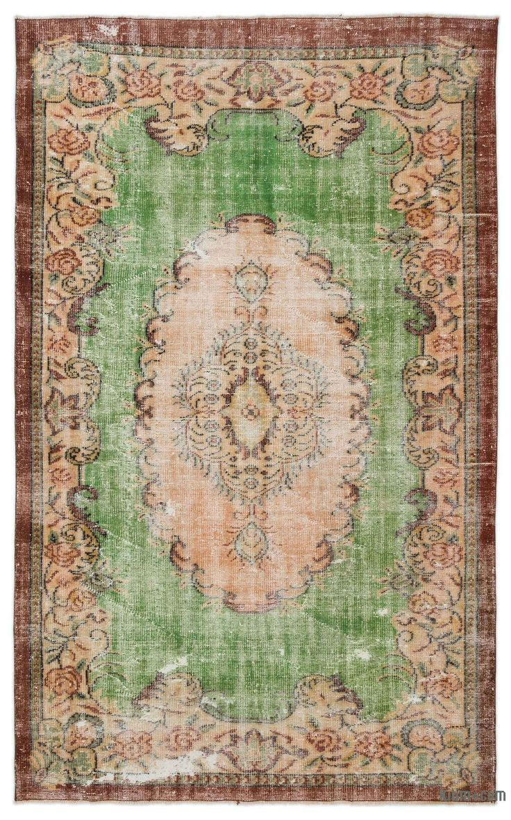 "For a contemporary look with a vintage appeal, we source rugs in excellent condition and carefully trim the piles to achieve an eye-catching ""distressed"" look. Woven with wool on cotton, this fine rug measures 5'11'' x 9'6'' (71 in. x 114 in.). In addition to being unique and hand-made, these rugs make a very special statement about bridging generations of artisanal skill and knowledge over time with a charming look that complements any modern or bohemian décor. Check out our article Get Th…"