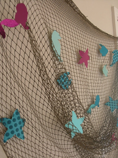 Decorations for round the pond with mermaid tails in the water!