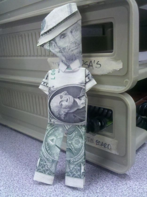Make an Abe Lincoln doll out of money. | 27 Pointless Projects To Do When You're Bored At Work