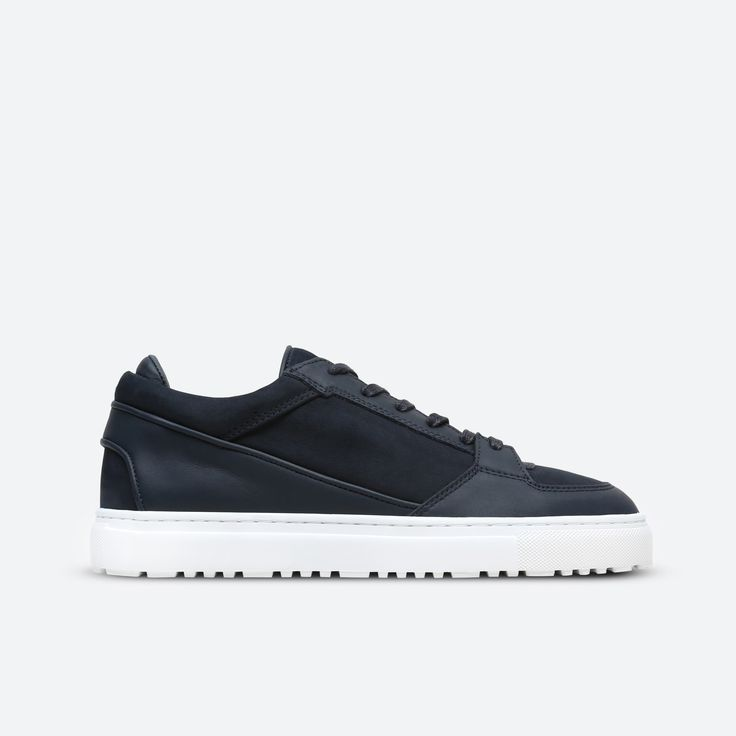 Low-top sneaker crafted from Nubuck leather in Midnight. Tonal leather trim, lace-up closure and a white rugged rubber cup sole unit. Full calf leather lining and insole. Comes in a branded box with a dust bag and a spare set of waxed laces.