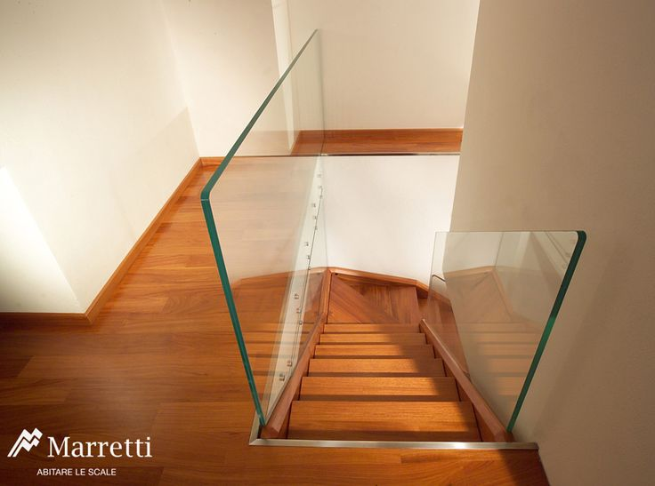 Double strip staircase and steps in solid doussié wood with banister in extra-transparent structural glass