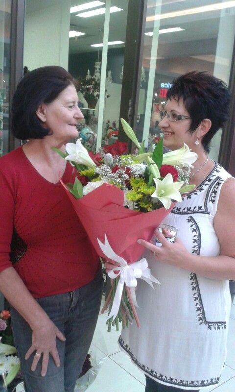 The Azalea Florist - Valentine's Day Competition 2016 winner......  Liza Grobler collecting her flower with Marita Hattingh congratulating her.