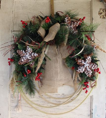Western lariat rope cowboy Christmas wreath with burlap, christmas greenery, berries, holly, pine cone stars, and bling