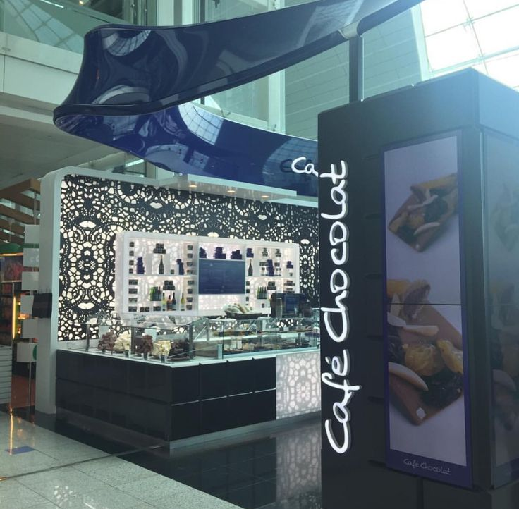 Cafe chocolat at the Dubai international airport. Chocolate cafe design with detail and specialist treatments.