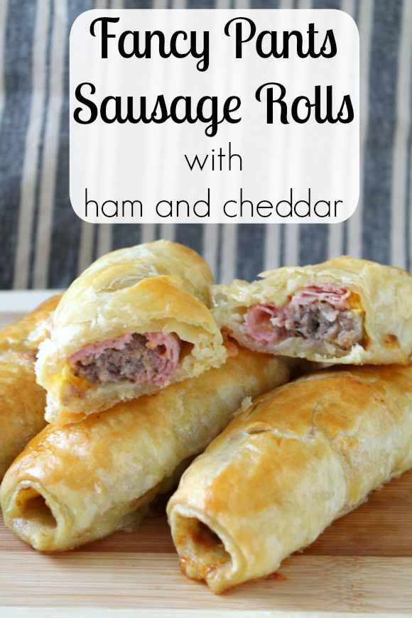 Traditional sausage rolls are made fancy with a slice of ham, a pinch of sharp cheddar, and a shot of mustard.