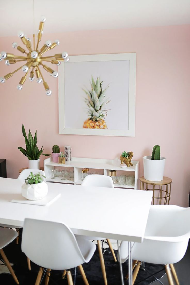 Soft pink dining room with white and gold accents