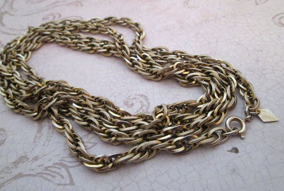 """Vintage Sarah Coventry Necklace 1970s - gorgeous and versatile, super long chain necklace in beautiful antiqued gold tone with shiny and textured oval links - lovely rope chain style, closing with round spring clasp / nicely weighted and perfect to wear long or in wrapped layers / add your favourite pendant for your own vintage fashion style statement .. goes with everything! - Length - 47.5""""  -  TheBeadSource"""
