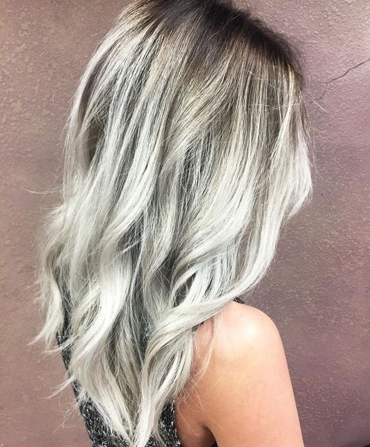 Slate silver ice blonde with a dark root