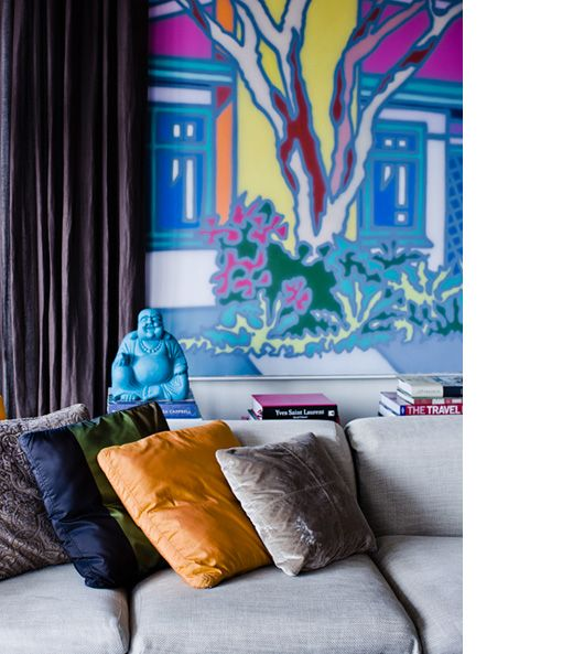 Painting in loungeroom by Howard Arkley, and Buddha from Ubud, Bali. Photo by Sean Fennessy, production by Lucy Feagins / The Design Files