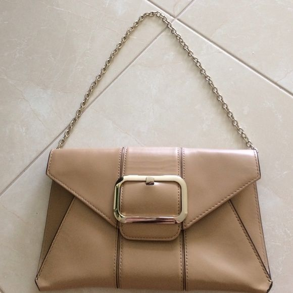 HOLIDAY SPECIAL Banana republic hand bag Tan leather with gold buckle and chain, can be worn on the shoulder or tuck chain in purse and wear it as a clutch, great condition, never worn Banana Republic Bags Clutches & Wristlets