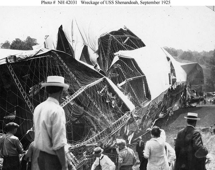 The wrecked airship's after section, taken soon after she crashed in southeastern Ohio.  This view looks aft along the port side of the after section, with the port horizontal tail fin in the distance.  Photograph was received from the Office of Naval Intelligence, 7 November 1940.    U.S. Naval Historical Center Photograph.