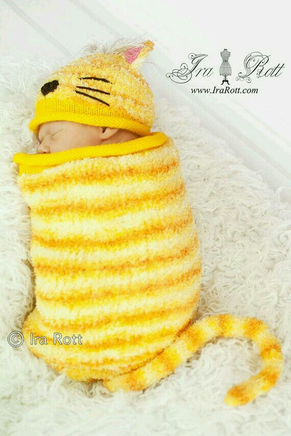 Kitten baby cocoon. So cute! I'd love to see it in a variegated light grey yarn.