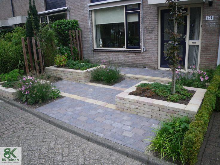Voortuin met verhoogde borders www.groenehanden.nl