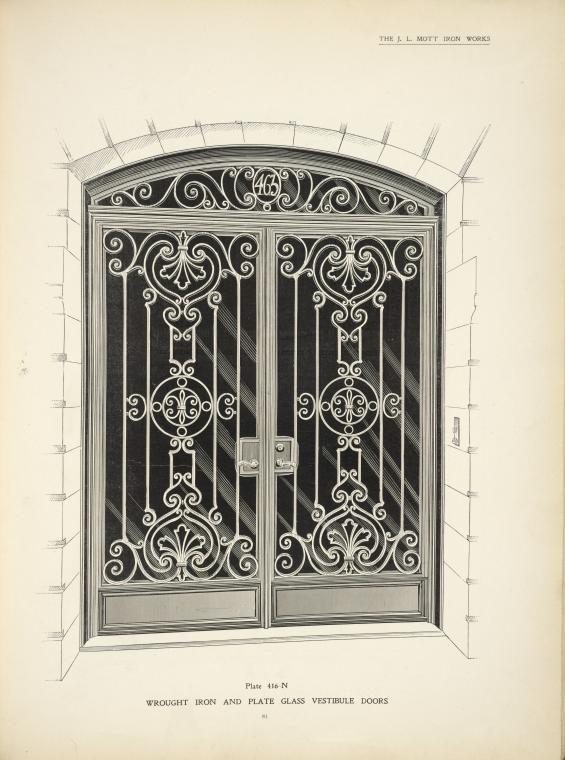 Wrought iron and plate glass vestibule doors.
