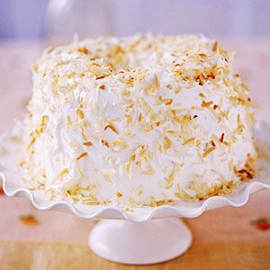 Build this towering beauty with a purchased angel food cake or one from a mix. Spread the layers with a creamy coconut and pecan filling, frost with billowy whipped cream, and sprinkle with toasted coconut.