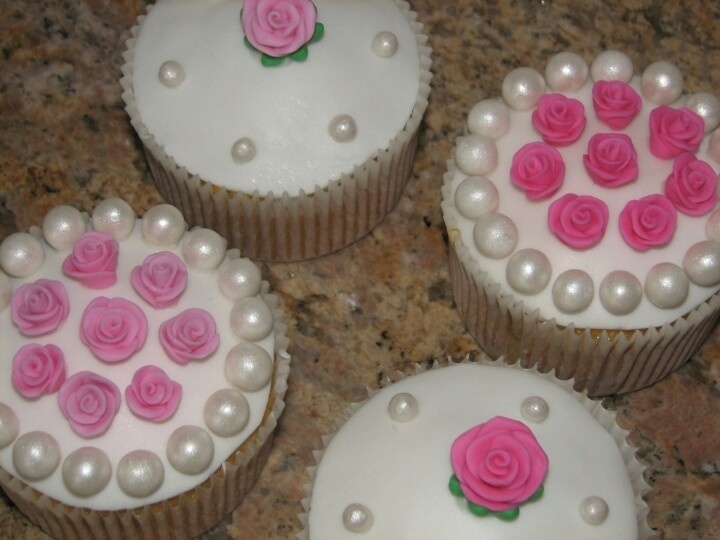 Fondant covered giant muffin size Cupcakes with hand made roses and pearls